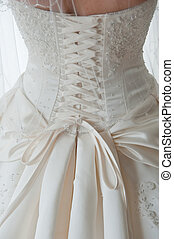 Detail shot of laces on back of wedding dress - Close-up...