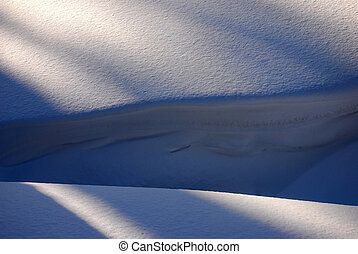 detail snowdrifts, light and shadow under the snow