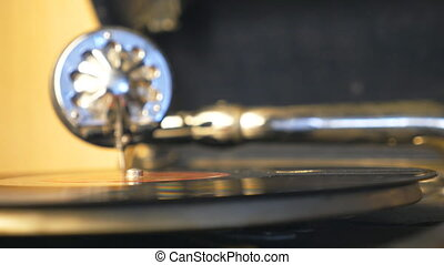 Detail view of black vinyl record spinning on old turntable....