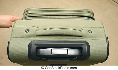 Detail zip with hand on a suitcase - Detail zip with hand on...