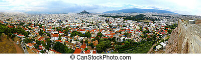 Detailed Panorama of Athens Greece bird's-eye view over the large city on a cloudy day colorful summer picturesque wide angle vast landscape