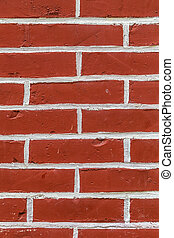 pattern of red painted brick wall