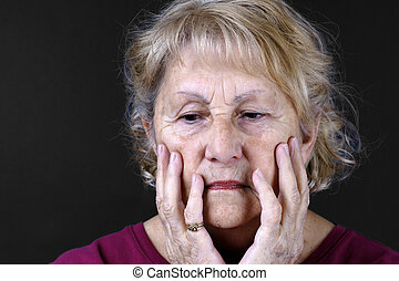 Detailed portrait of a sad senior woman