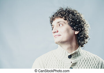 Detailed portrait of a young guy with curly hair