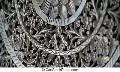 Detailed shot of a metal carving decoration - A close up...