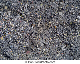 Detailed texture of old asphalt with stones