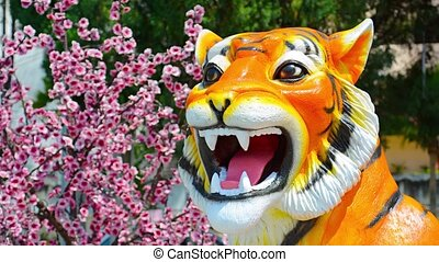 Detailed Tiger Statue outside Buddhist Temple in Southeast...