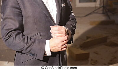detailed view of a good dressed man at a building lot