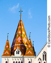 Detailed view of colorful tower rooftop of Matthias Church,...