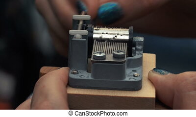 Detailed view of the insides of an old vintage music box as...