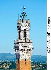 Detailed view of Torre del Mangia, city tower in Siena, Tuscany region, Italy, Europe