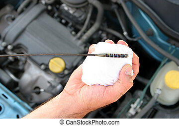 checking engine oil dipstick in car
