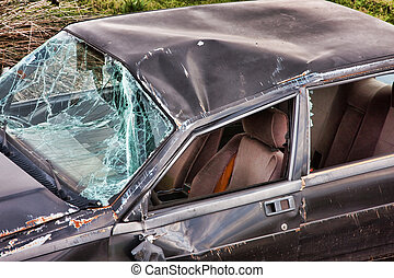 Details of a crashed car - Hood and windshield of a crashed...