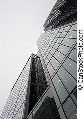 Modern glass skyscraper office building