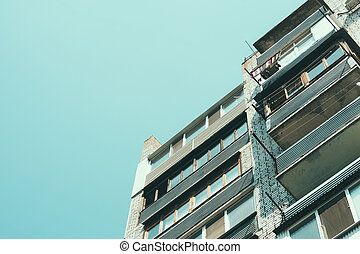 Details of a residential apartment building with balconies in a cheap area