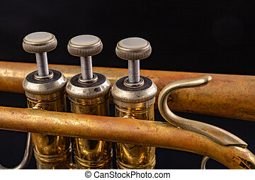 Details of an old patina covered trumpet. Musical instrument shown in magnification.