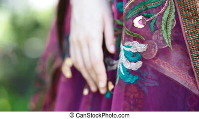 Details of asian ethnic dress. Young asian woman pose to...