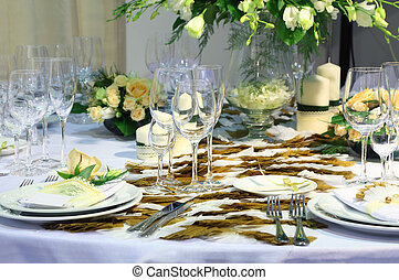 Details of beautiful table set for wedding dinner - flowers, plates and glasses