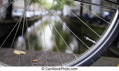 Details of bicycle wheel at Amsterdam canal, Autumn,...