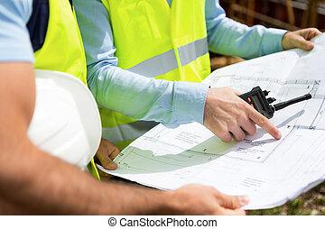 Details of blueprints on a construction site