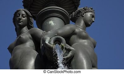 Details of bronze statues - the Fountain of the Three Graces...