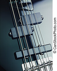 details of electric bass, pickups and cords - closeup of...