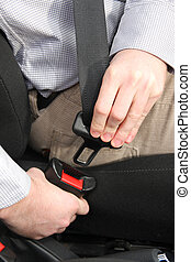 safety belt - details of hands putting on safety belt