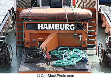 """details of Old german boat with a title """"Hamburg"""" in a port Ham"""