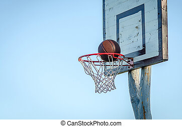 Details of outdoor basketball with the blue sky as the background