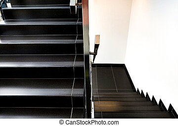 Details of railing and stairs of a modern building.