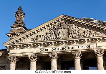 Details of the Facade of the German Parliament against a Clear Blue Sky