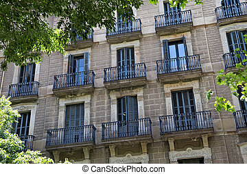 Details of the one of old residential buildings in the historical center of Barcelona in sunny day. Spain.