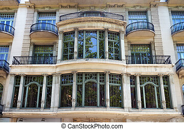 Details of the one of typical old buildings in modern style in the historical center of Barcelona in sunny day. Spain.