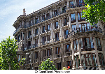 Details of the one of typical old residential buildings in modern style in the historical center of Barcelona in sunny day. Spain.