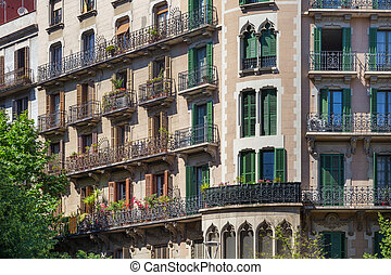 Details of the one of typical old residential buildings in the historical center of Barcelona in sunny day. Spain.