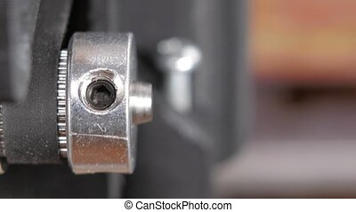 Details of the printer close-up. Stepper motors move the belt extruders. Close-up