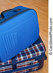 Details of colored cloth travel bag on the wooden top