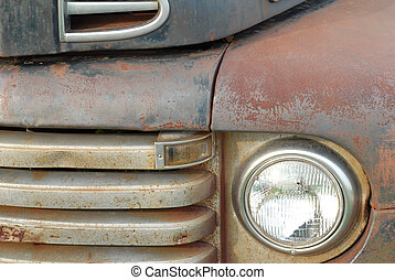 details on the front of a rusted old pick up truck