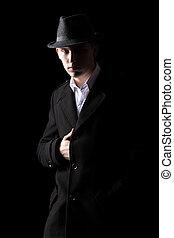 Detective in hat