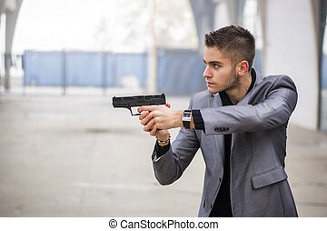 Detective or mobster or policeman aiming a firearm - Well...