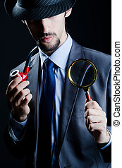 Detective with magnifying glass and pipe