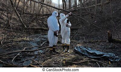 Detectives collecting evidence in a crime scene. Forensic ...