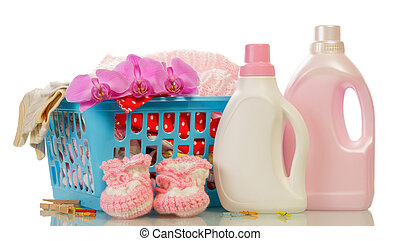 Detergent and baby's booties - Clothes with detergent and...