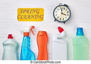 Detergent bottles on wooden background.