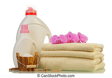 Detergent in bottles and towels isolated on white background