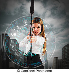 Determined businesswoman with bow and an arrow
