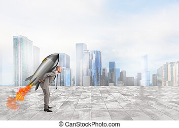 Determination and power businessman that holds a rocket -...
