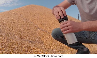 Determination of moisture content of grain yield in field...