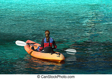 Determination - Person rowing on a canoe (kayak)