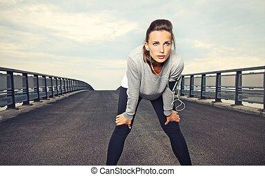 Determination - Female runner with focus and determination...
